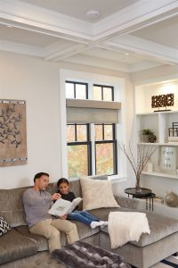 father and daughter reading book in living room | Xcellence Inspection Services | carbon monoxide Chicago