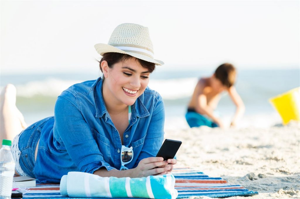 woman in summer vacation | Xcellence Inspection Services | Summer Travel Season Chicago